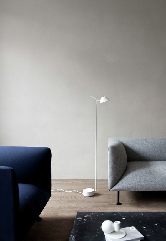 a minimalist white floor lamp with a small lampshade is great for reading