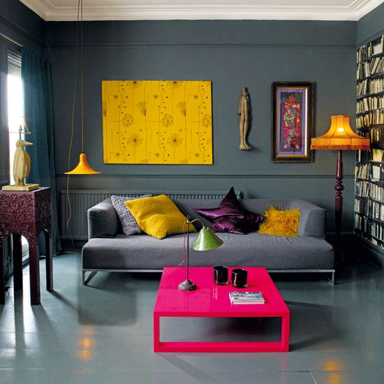 bright yellow, hot pink and deep purple accents in a grey room make it stand out
