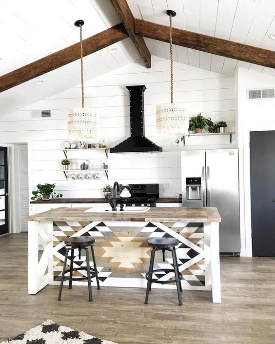 macrame lampshades, a mosaic kitchen island and wooden beams for a relaxed modern boho look