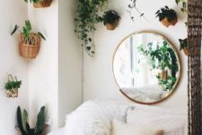 23 turn your bedroom into a jungle with lots of potted greenery on the walls around the bed