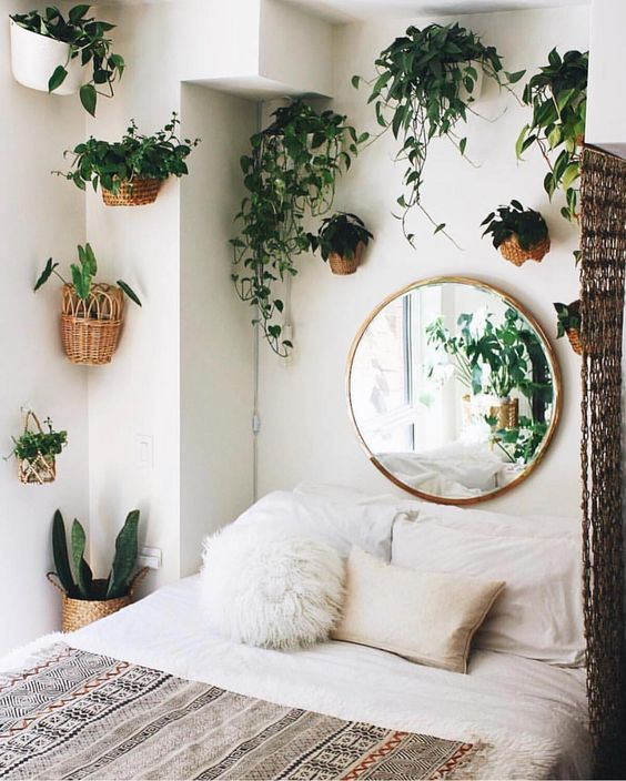 turn your bedroom into a jungle with lots of potted greenery on the walls around the bed