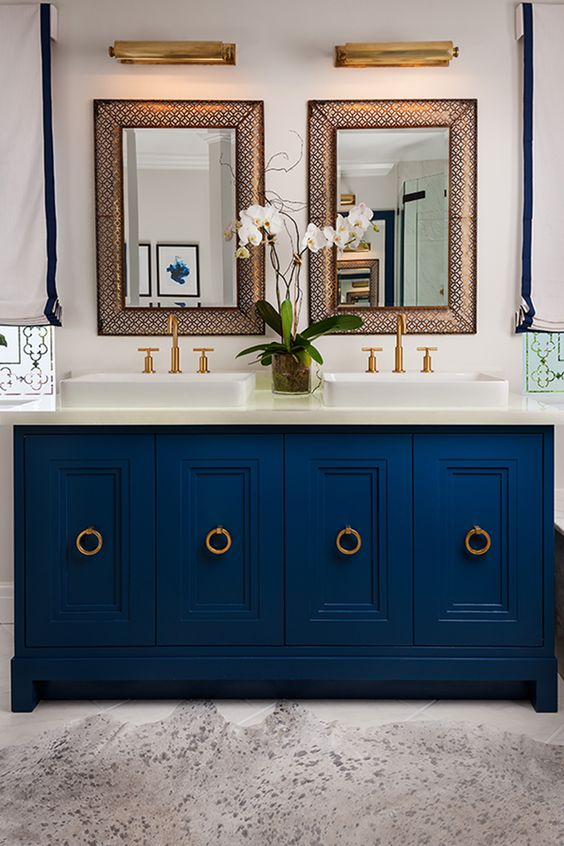 a chic navy bathroom vanity with ring pulls in brass adds an elegant feel to the bathroom