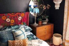 24 a macrame and bead chandelier, printed textiles and a lot of potted greenery make the space boho