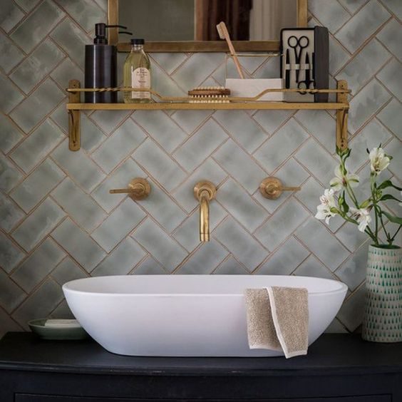 make your bathroom wow with pattern clad tiles and brass grout plus brass fixtures and shelves