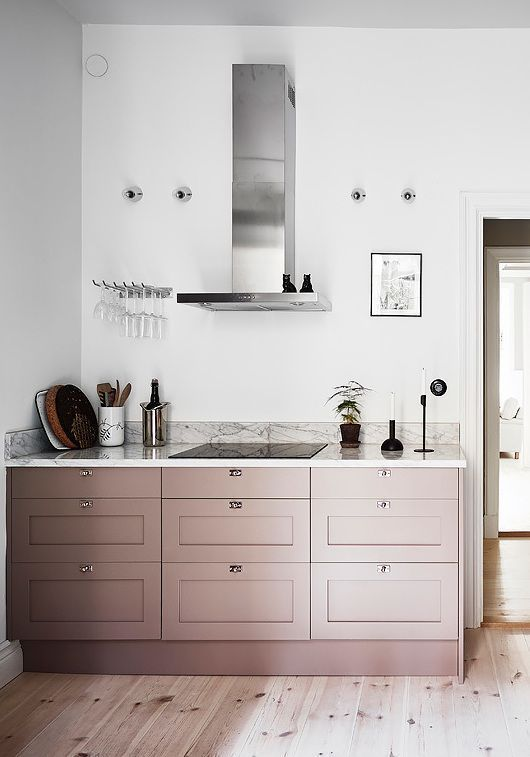 pale pink cabinets for adding a tender touch of color to the neutral kitchen