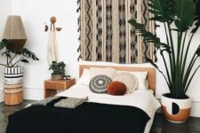 25 a boho textile artwork, a black tassel bedspread, potted greenery for creating a bold boho look