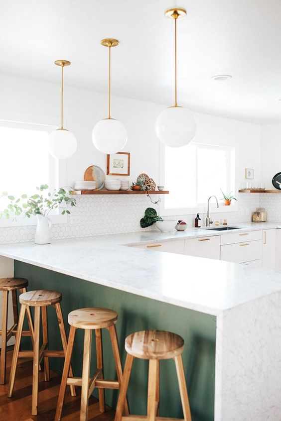 white cabinets and a green kitchen island are united with the same countertops for a continuous look