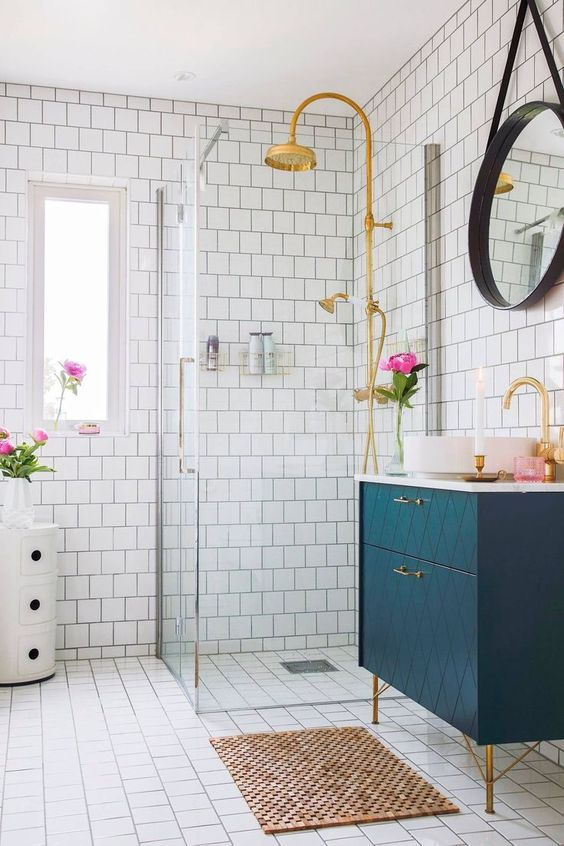 a chic geometric navy vanity with brass touches looks wow and bold and will add chic to the space