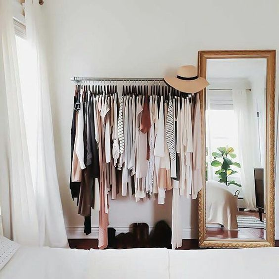 a makeshift closet is a popular idea, which is great for small space to keep them airy