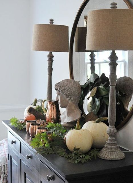 easy fall styling with white pumpkins, fresh greenery, copper mugs and a jug