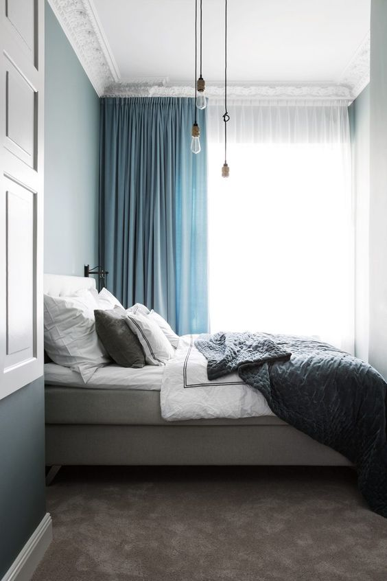 two-toned blue curtains spruce up the greys used for bedroom decor and enliven the space