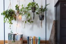 26 use your old clothes rack to display some cool potted plants in an unusual way