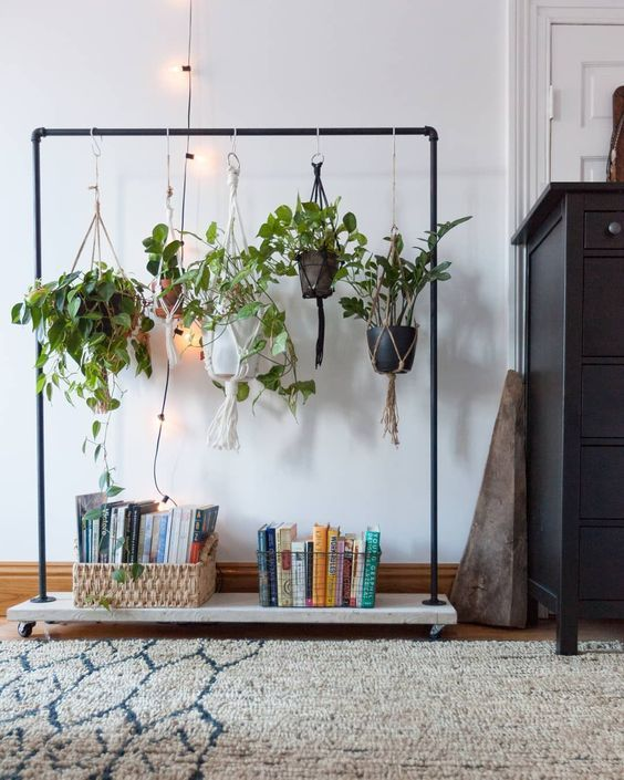 use your old clothes rack to display some cool potted plants in an unusual way