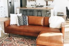 26 wooden and leather touches of similar touches warm up and cozy up the layout