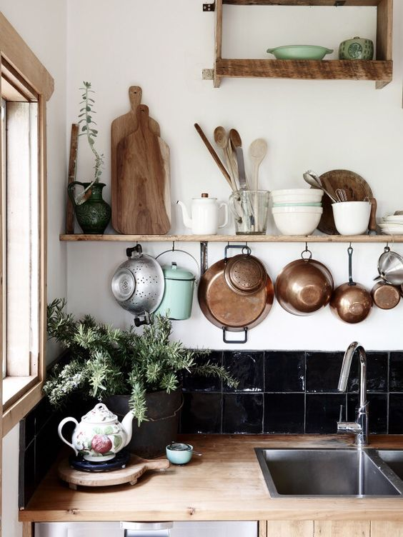 wooden details, potted greenery and copper pots for a stylish boho feel