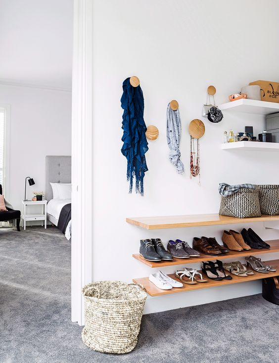 attach some wall shelves and stylish hooks to organize your clothes and accessories