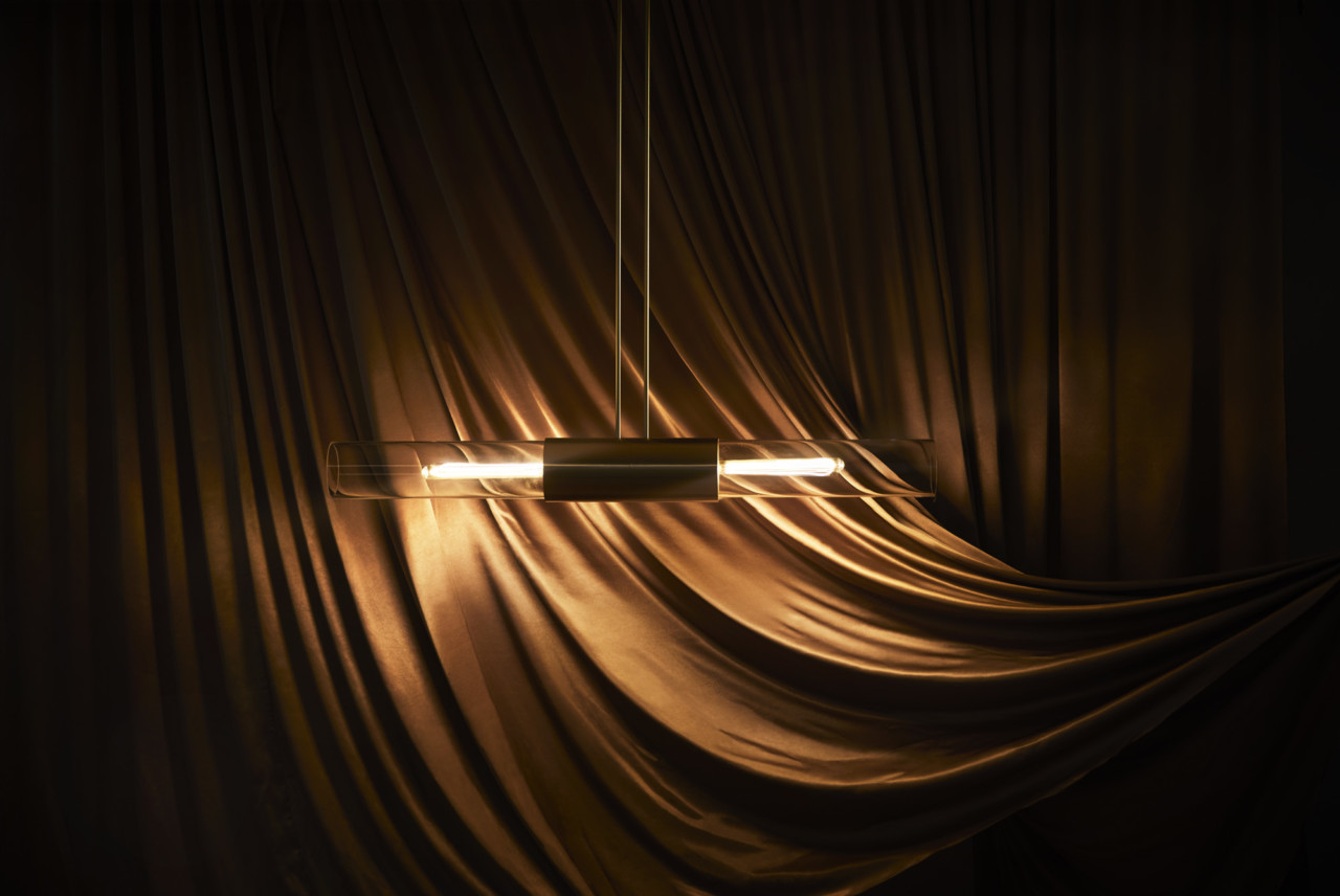 The Glimpse pendant lamp is a horizontal feature inspired by the sunlight streaming across the horizon