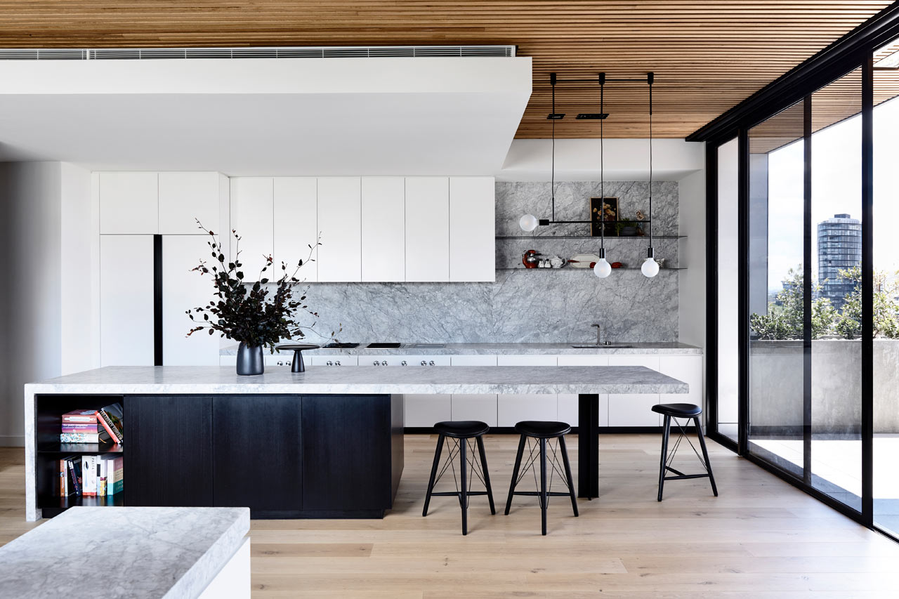 This fabulous penthouse in Melbourne is filled with natural light, done with catchy materials and finishes and bold design features
