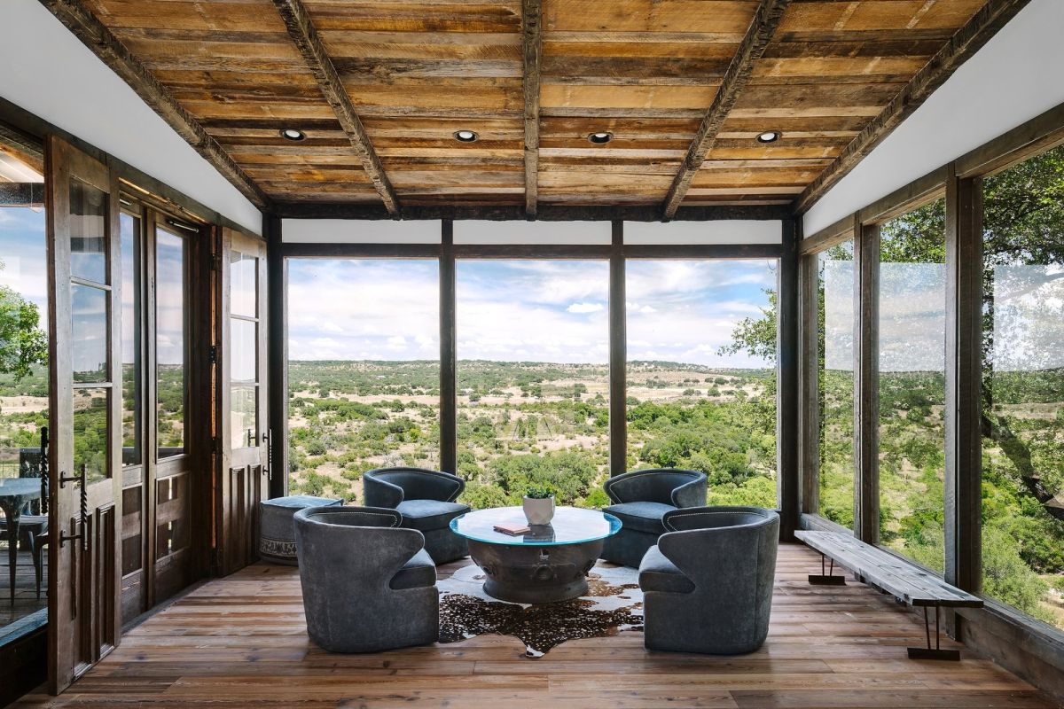 This gorgeous house with extensive glazing offers amazing views and a contemporary meets rustic design