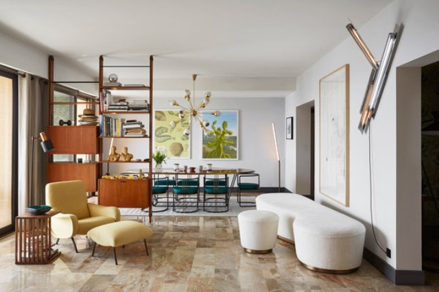 This gorgeous large apartment is done in a mix of art deco and mid century modern styles and reflects the Riviera lifestyle
