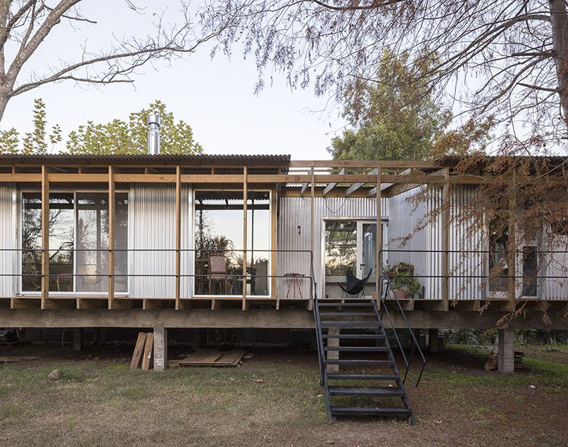 This house in Buenos Aires is inspired by traditional huts of river delta and is placed on stilts to avoid floods