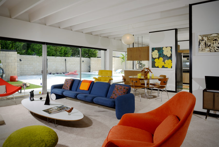 This mid century modern house is a neutral space done with colorful furniture and textures