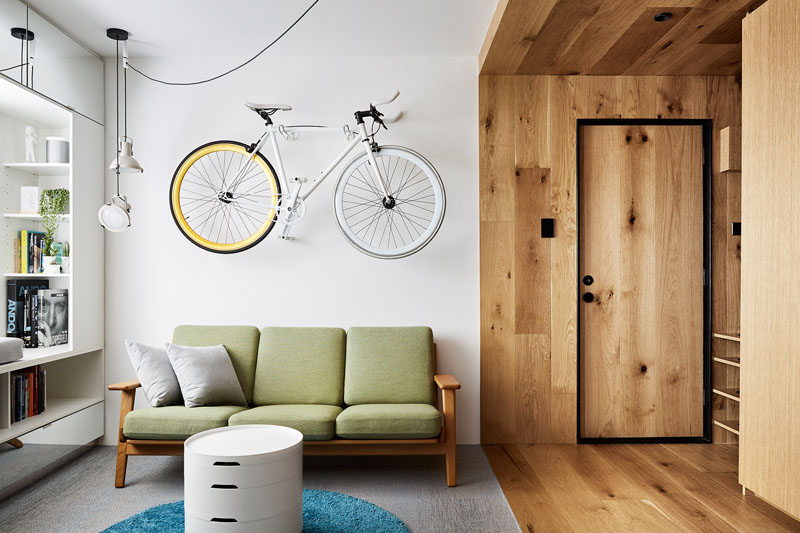 This small apartment features a lot of hidden storage elements and space saving solutions