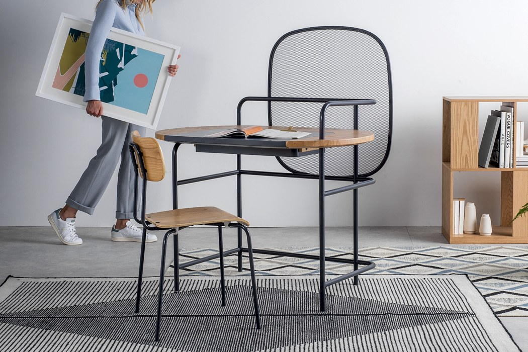 This ultra modern desk is a whole workstation, with a hidden storage space and a creative design