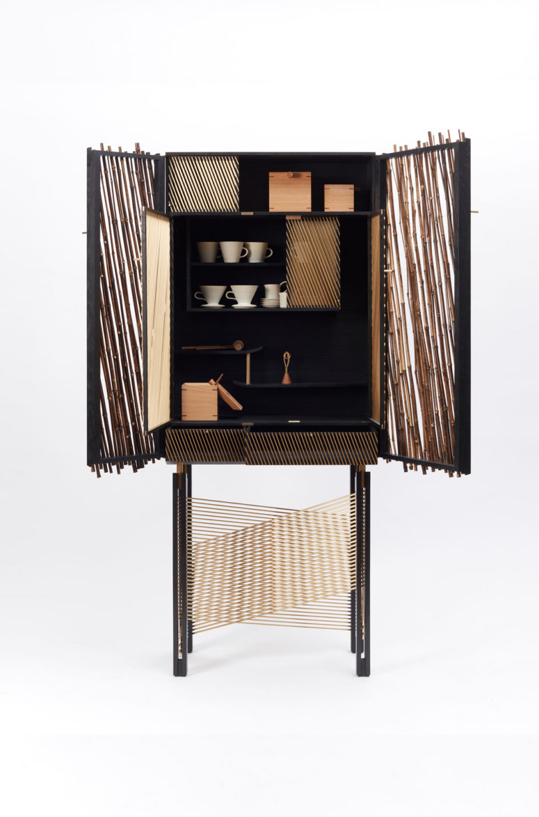 The cabinet combines Japanese bamboo, wood stained with Japanese calligraphy ink