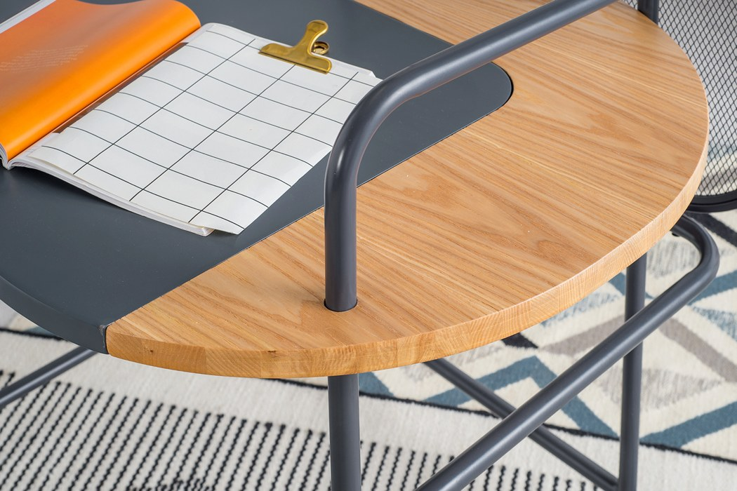 The desk is made of plywood and metal painted grey with a matte finish