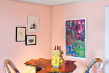 02 The dining room is super colorful, with bold chairs, an artwork, a pendant lamp and look at these table legs