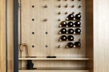pegboard storage right in an entryway storage unit