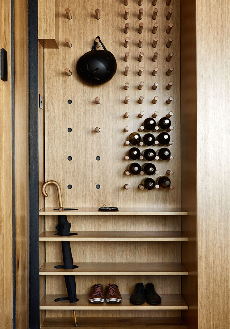 The entryway unit features a pegboard and some shelves