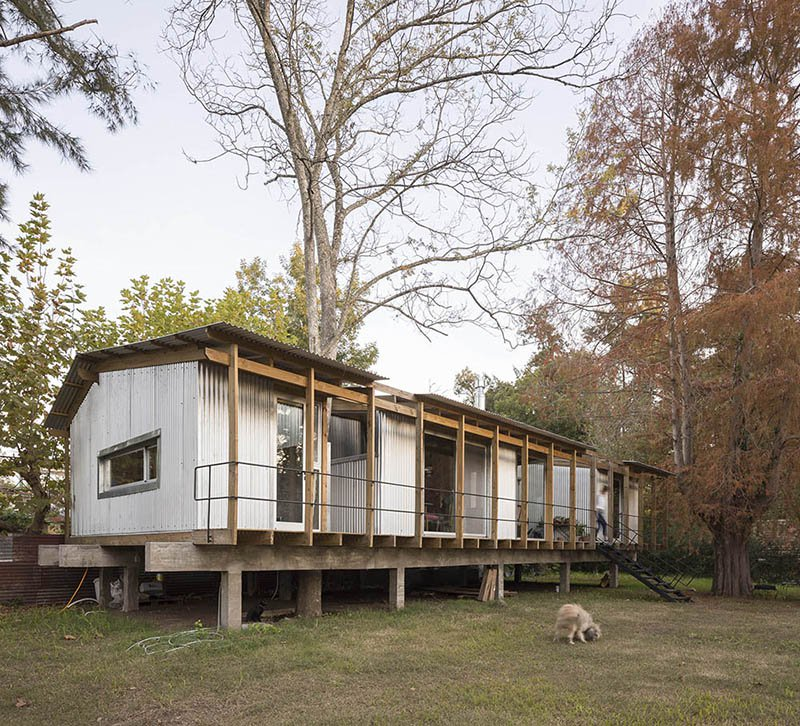 The house features several volumes that are opened to outdoors and are connected to each other