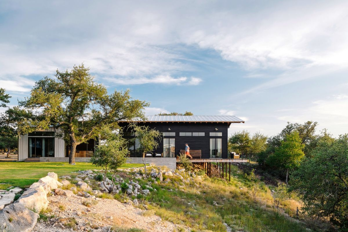 The house sits on the top of a bluff and overlooks a forest offering these views