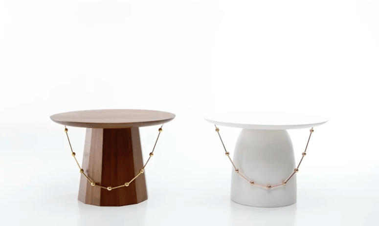 The shape of the tables is also inspired by traditional Korean tables and the pieces are decorated with beads to remind of the hats