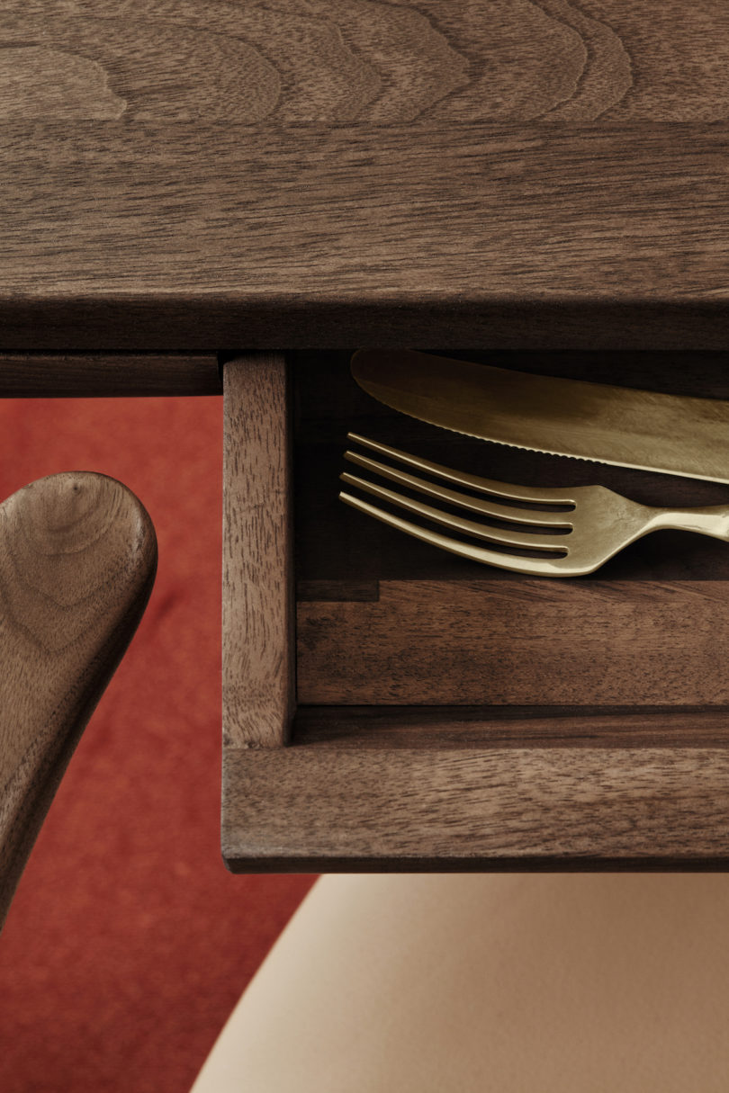 There's a small drawer concealed in the table, it may be used for storing cutlery
