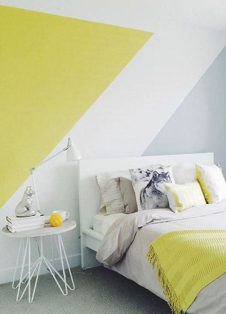 a color block wall in grey, white and mustard and a matching bedding set for more brightness