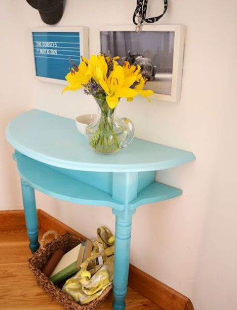 a half cut table painted bold is the best idea for a small entryway where you need a console