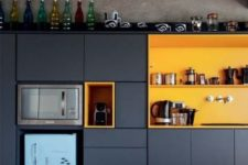 02 a navy kitchen with yellow compartments is color block piece itself and is a bold statement
