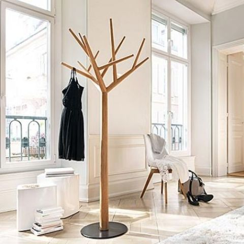 a wood and metal coat rack imitating a real tree is a fresh idea for a modern entryway
