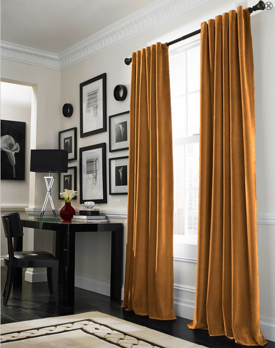velvet curtains in mustard color is a cool touch to your bedroom and will keep the cold away