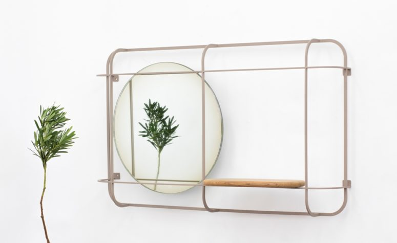 Encased in a steel frame, the Margin mirror has a round shape with a slight gradient