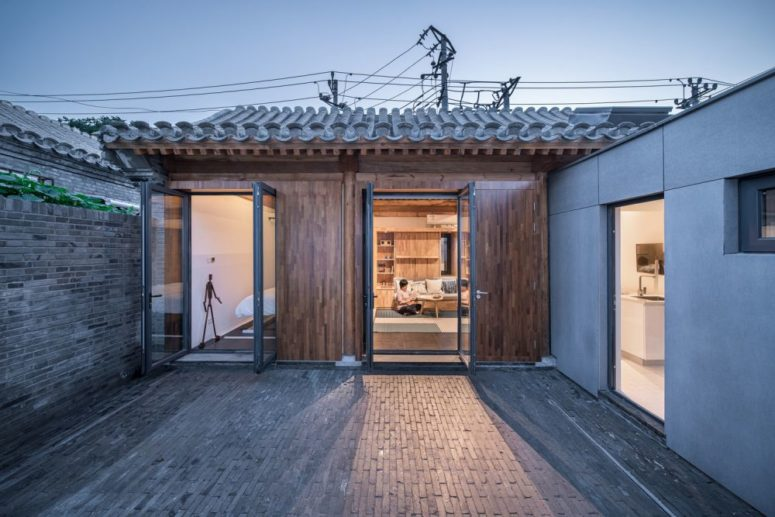 Glass doors allow a seamless connection to outdoors and fill the spaces with light