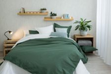 03 If you like bold colors, try a white and emeralf bedding set with a contrast
