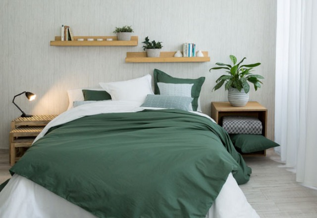 If you like bold colors, try a white and emeralf bedding set with a contrast