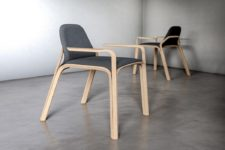 03 The chair is made of oak and dark grey felt, which contrast each other