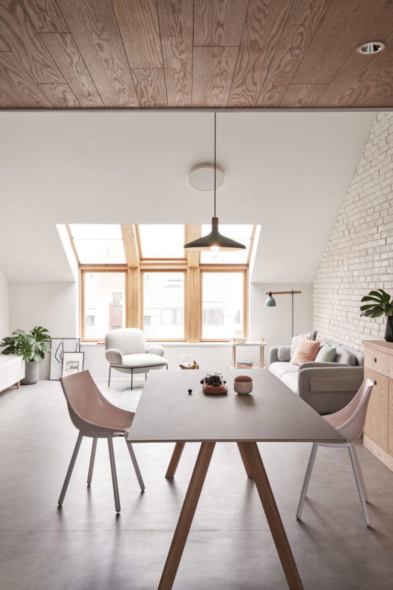 The dining space is done with a comfy trestle table and modern chairs