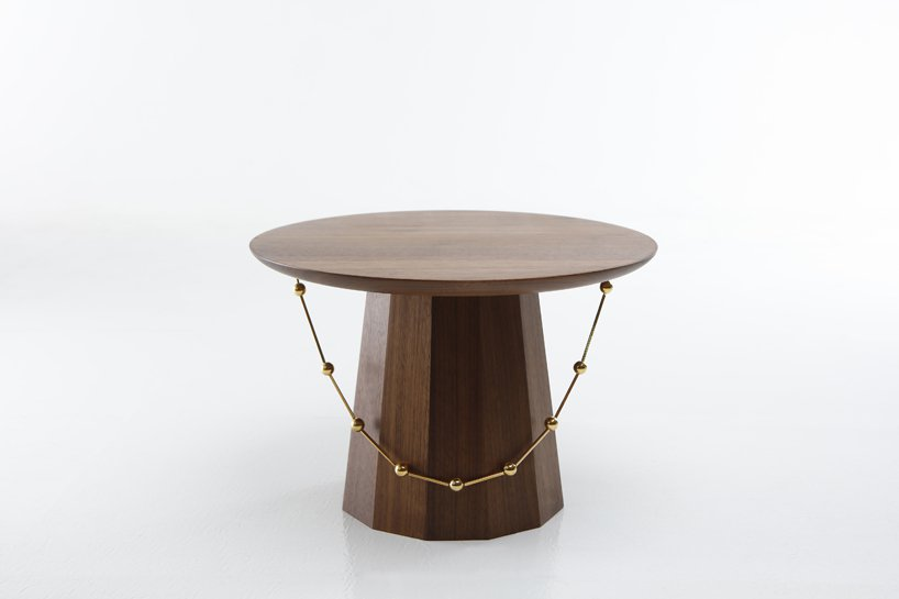 The tables are available in different finishes and materials, here it's walnut with faceted sides