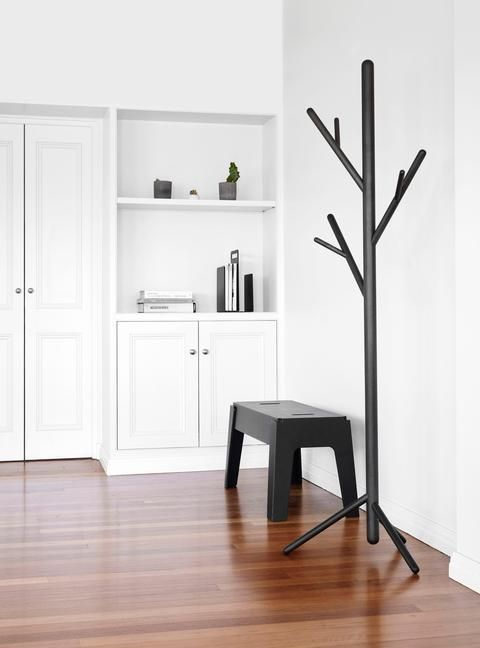 a black metal stem coat stand is right what you need for a minimalist space, spruce it up with its original design